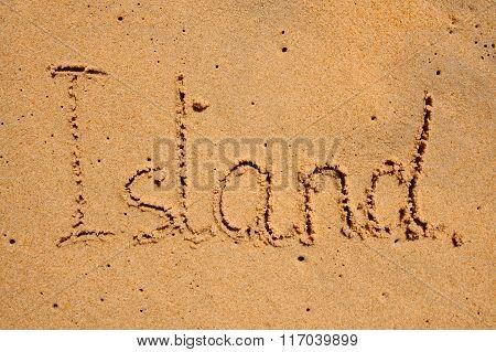Beach Sand With Written Word Island