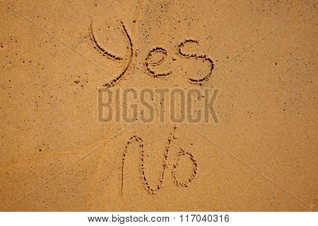 The Words Yes And No Written In Beach Sand