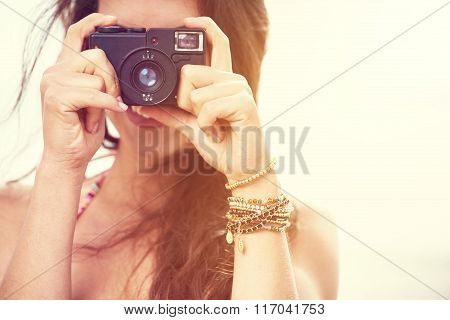 Close up Portrait of beautiful  woman with retro hipster camera