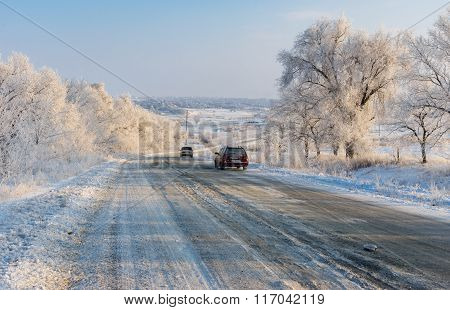 Private transport moving on a country slippery road at winter season