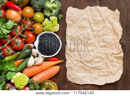 Uncooked Black Lentils With Vegetables And Craft Paper