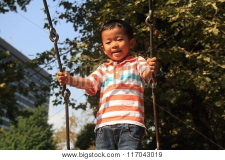 Japanese boy on the swing (3 years old)