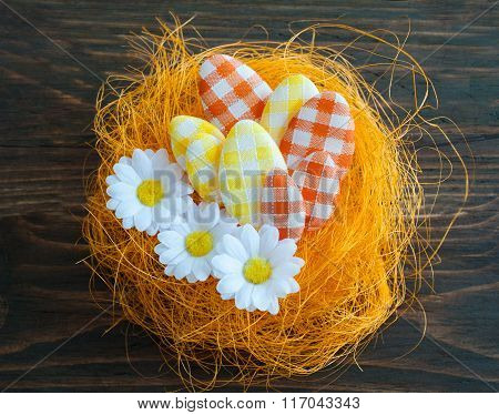 Easter eggs in an artificial nest