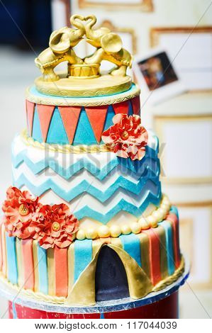 Delicious beautiful wedding cake with modern decoration.