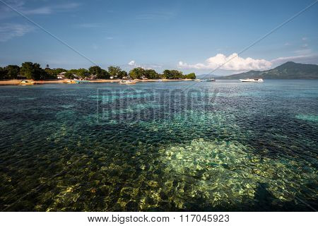 Tropical island of Bunaken surrounded by coral reefs. Indonesia