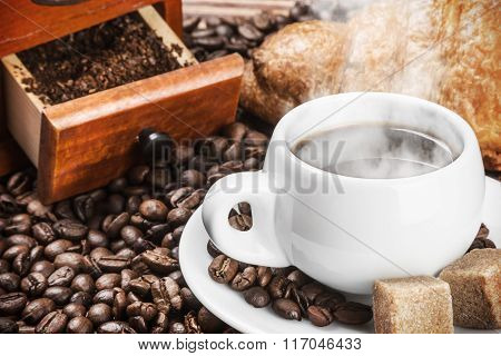 Cup Of Warm Coffee And Coffee Beans