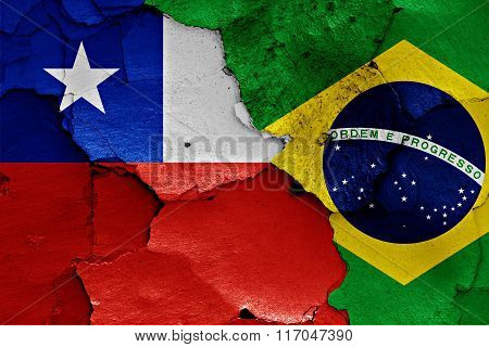 Flags Of Chile And Brazil Painted On Cracked Wall