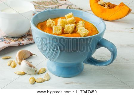 Pumpkin Soup With Croutons In A Blue Bowl