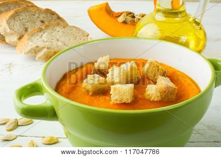 Creamy Pumpkin Soup With Croutons In A Green Bowl