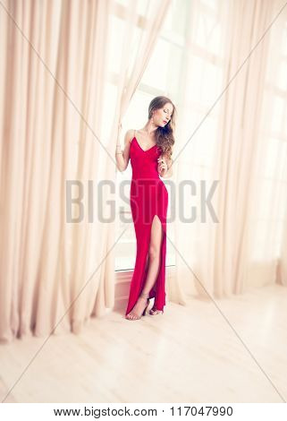 Beautiful Young Woman In A Long Red Dress In A Classical Interior. Soft Focus
