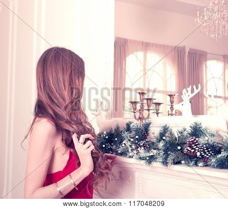 Young Woman In A Classical Christmas Interior. Holiday Concept