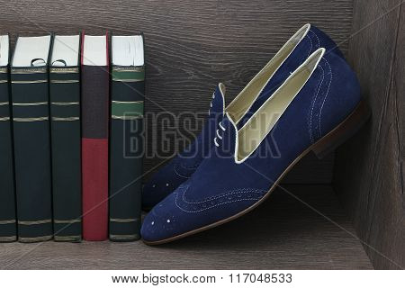 Men's leather shoes besides books