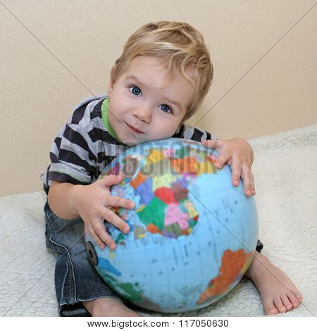 Little White Boy In Jeans Laid His Head On The Globe. Baby Embraced The Globe. We Need To Protect Th