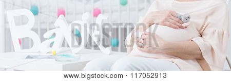 Elderly Woman In Infant Room