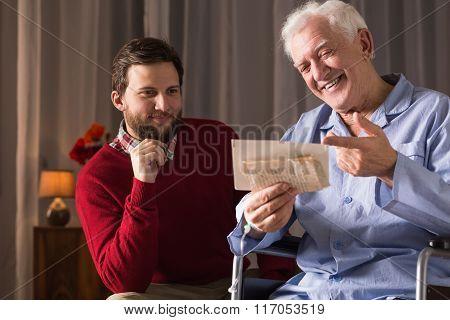 Carer Assisting Disabled Man