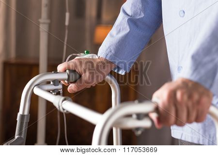 Ill Man Using Walking Frame