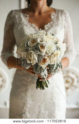 Beautiful wedding bouqet in hands