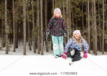 Expressive Girls On Snow Hill Looking At Camera