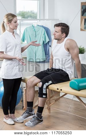 Physiotherapist Discussing Medical Treatment