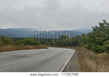 Picturesque road through Balkan mountain in cloudy day