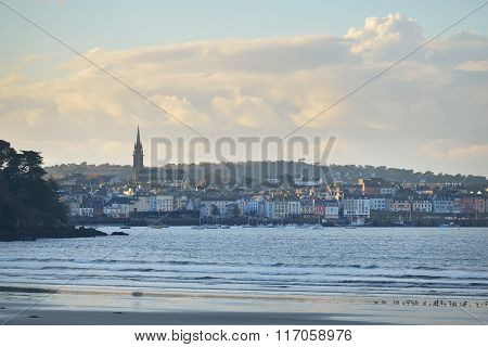 View of Douarnenez city in France and the ocean bay at sunset