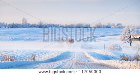 Fog Over A Snowcovered Rural Highway During Winter Sunset