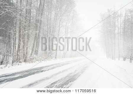 Snowy Winter Road During Blizzard In Latvia