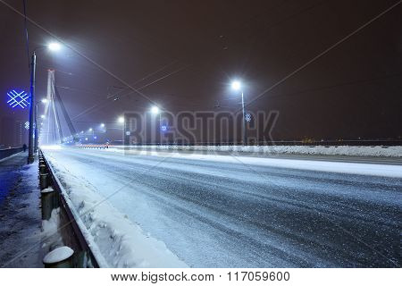 Riga Bridge (vansu Tilts) At A Snowy Winter Night With Christmas Illumination