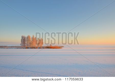 Sunrise At A Frozen Lake In Riga, Latvia During Hoar Frost