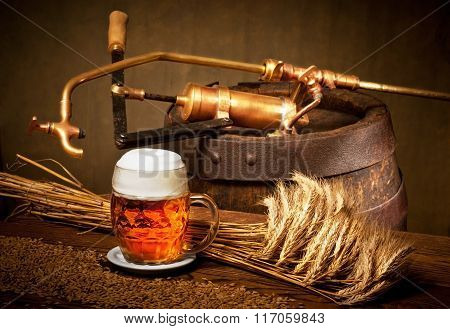 Glass Of Beer With Barley And Old Wooden Barrel