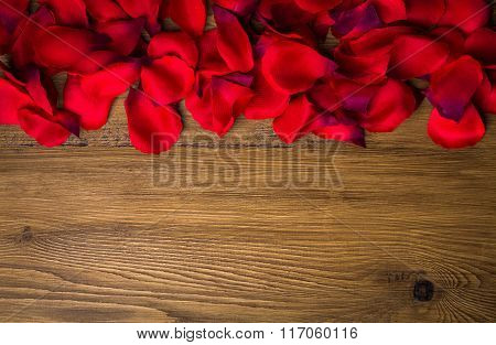 Beautiful Red Rose Petals On Rustic Wooden Background. Top View