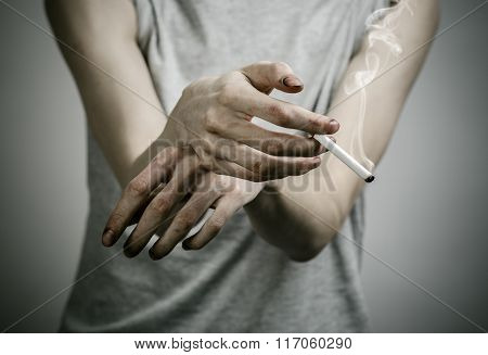Cigarettes, Addiction And Public Health Topic: Smoker Holds The Cigarette In His Hand And A Red Hear