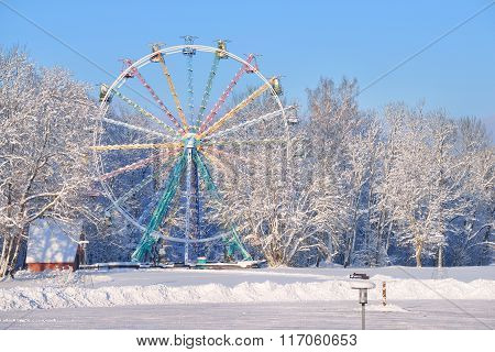 Snow Covered Ferris Wheel In Sigulda, Latvia, Surrounded By Snowcovered Trees