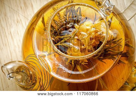 Flowering Blooming Exotic Green Tea In Glass Teapot, Top Close Up View
