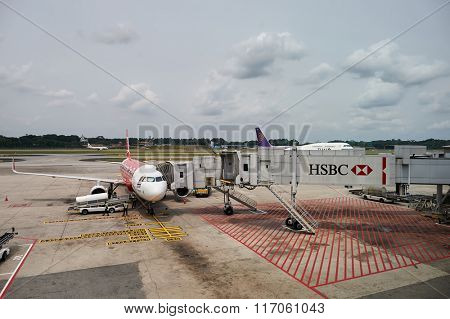SINGAPORE - NOVEMBER 04, 2015: A320 docked at Changi Airport. The Airbus A320 family consists of short- to medium-range, narrow-body, commercial passenger twin-engine jet airliners