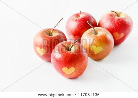 Red apples with a heart symbol