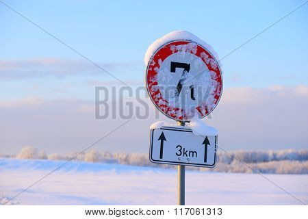 7 Ton Limitation Sign Covered With Snow On A Rural Road