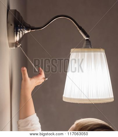 cute boy looking on the lamp
