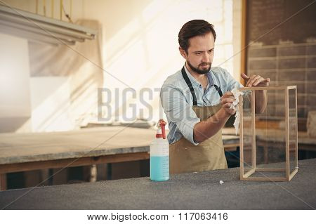 Designer finishing his woodwork project with concentration