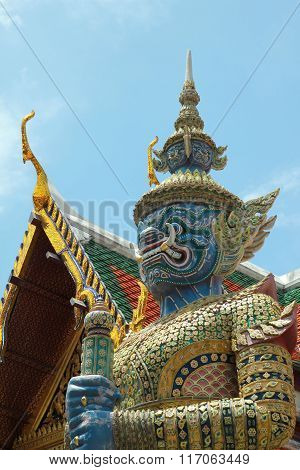 Ancient Sculpture Of Thai Demon On Traditional Roof Background Wat Phra Kaeo Bangkok Thailand