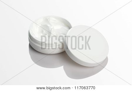Blank Cosmetic Cream Pack Mockup On White Reflective Background
