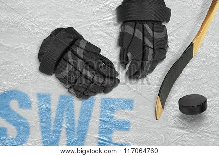 Swedish Stick, Gloves And Puck On The Ice