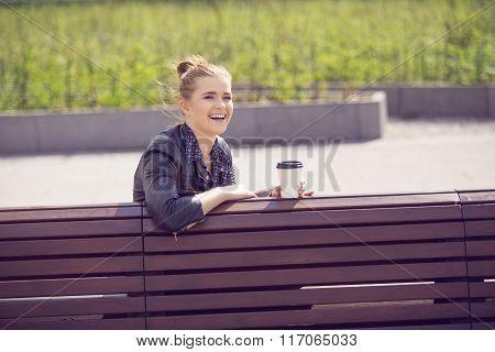 Joyful Young Woman Having Coffee Break