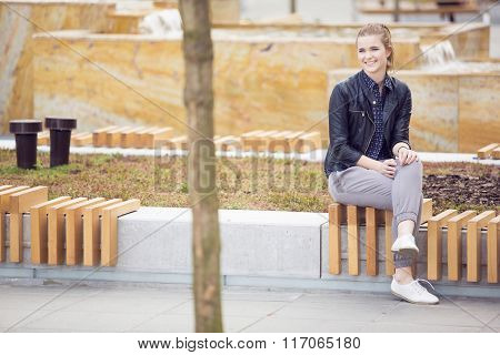Smiling Woman Sitting On A Bench On Fresh Air