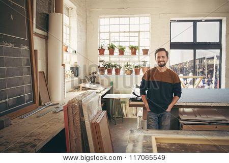 Craftsman looking comfortable and confident in his workshop
