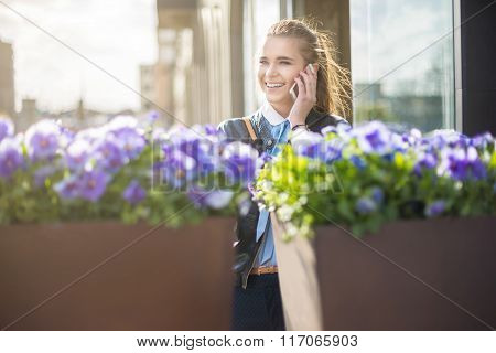 Cheerful Woman On The Phone In City Center