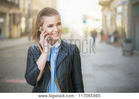 On The Phone In City On Sunset