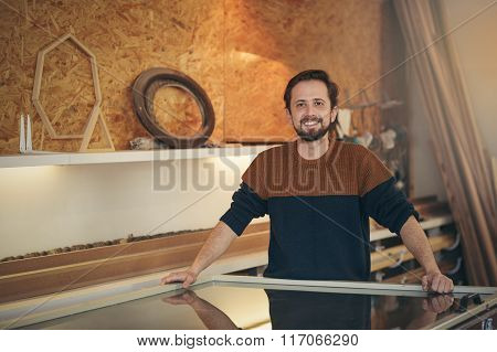 Professional craftsman in his design studio looking positive