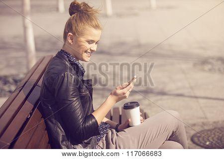 Young Joyful Woman Texting On A Fresh Air