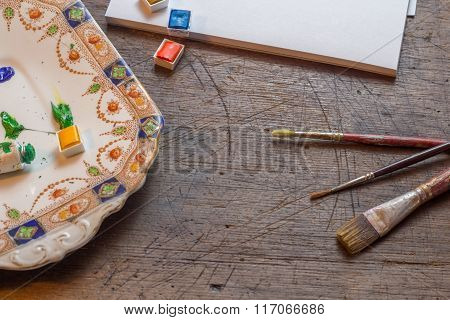 Old Paintbrushes With Watercolor Or Watercolour Paint And Paper